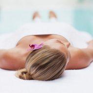 spa-woman-flower-pool-e1541851294270